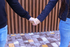 Loving people firmly hold hands and overcame each other, standin stock images