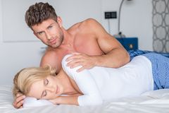 Loving romantic couple in bed Royalty Free Stock Image