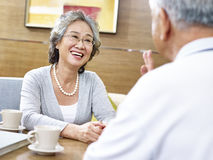 Loving senior asian couple chatting Stock Image