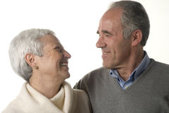Loving senior couple. Looking at each other over white background Royalty Free Stock Photography