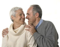 Loving senior couple. Looking at each other over white background Stock Photo