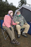 Loving Senior Couple On A Camping Trip Royalty Free Stock Image