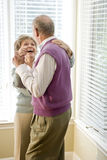 Loving senior couple dancing in living room Royalty Free Stock Photo