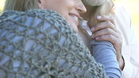 Loving senior couple embracing on cruise ship, tender relationship, tourism royalty free stock images