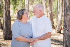 Loving Senior Couple Embracing Outdoors royalty free stock photography