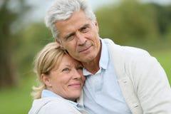 Loving senior couple embracing outdoors Royalty Free Stock Photography