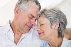 Loving senior couple with head to head Stock Photo