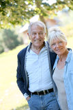 Loving senior couple outdoors walking royalty free stock image