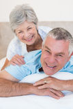 Loving senior couple relaxing in bed Royalty Free Stock Photography