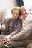 Loving Senior Couple Relaxing At Home Stock Photography