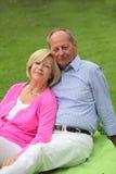 Loving senior couple relaxing outdoors Stock Photo
