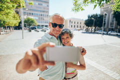 Loving senior couple taking a selfie Royalty Free Stock Photography