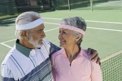 Loving Senior Couple At Tennis Court Royalty Free Stock Photo