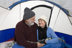 Loving Senior Couple In Tent Stock Photography
