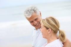Loving senior couple walking on the beach Royalty Free Stock Photo