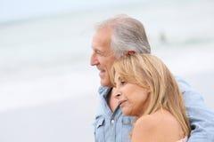 Loving senior couple walking outdoors Royalty Free Stock Photography