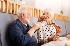 Loving senior man celebrating anniversary royalty free stock photos