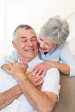 Loving senior woman embracing husband Royalty Free Stock Photography