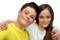 Loving siblings. Happy siblings, brother and sister embracing each  other Royalty Free Stock Image