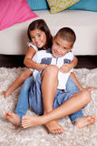 Loving siblings hug each other Royalty Free Stock Photography