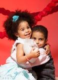 Loving siblings hugging Stock Photo