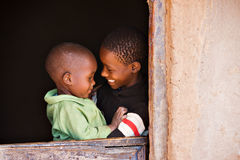 Loving sister. Brother and sister in the door of a hut  in an african village Stock Photo