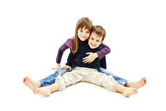 Loving sister and little brother hugging Stock Image