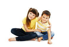 Loving sister and little brother hugging Royalty Free Stock Image