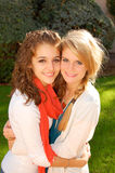 Loving Sisters. Two youthful sisters hugging who love each other royalty free stock photo