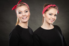 Loving sisters in retro pin up stylization. Stock Photography