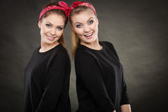 Loving sisters in retro pin up stylization. Stock Images