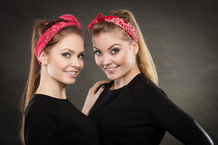 Loving sisters in retro pin up stylization. Stock Image
