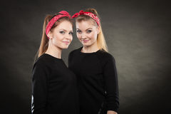 Loving sisters in retro pin up stylization. Royalty Free Stock Photos