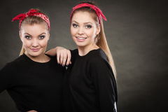 Loving sisters in retro pin up stylization. Stock Photo