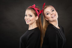 Loving sisters in retro pin up stylization. Royalty Free Stock Image