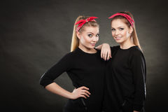 Loving sisters in retro pin up stylization. Royalty Free Stock Photo