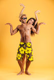 Loving smiling couple in swimwear having fun Stock Images