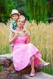 Loving son hugging his stylish mother in park.  stock image