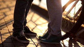 Loving sports couple will show their feelings at sunset on the waterfront stock footage