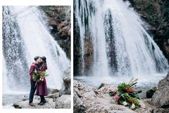 A loving, stylish, young couple in love on the background of a waterfall. royalty free stock image