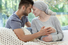 Pregnant wife suffering from cancer. Loving supporting husband and his pregnant wife suffering from cancer Stock Photography