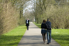 Loving teenagers. Two teenagers in love walking in the park Stock Images