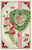 A Loving Thought Postcard 1915. A sentimental postage from 1915 sent to Bucklin, Kansas.  Pretty red, pink and white daisies alongside a four leaf clover heart Royalty Free Stock Photography