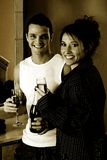 Loving Toast At Home. Monochrome image of a young and beautiful couple toasting champagne at home royalty free stock photography