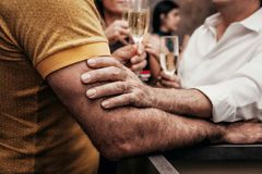 A loving touch in a party royalty free stock photo