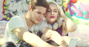 Loving trendy young couple taking a selfie stock footage