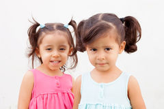 Loving twin sisters two years outdoors. Playing Stock Images