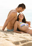 Loving two relaxing on sand beach Royalty Free Stock Photos