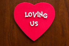 Loving us on a heart royalty free stock image