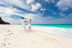 Loving wedding couple on beach. Loving wedding couple dancing on beach in white dresses Royalty Free Stock Images